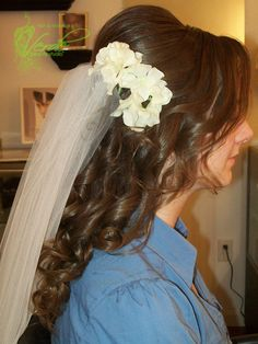 Long hair, large poof with fresh flowers and veil