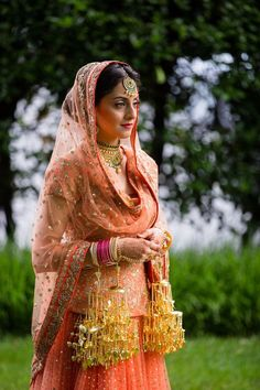 The bride looks breathtakingly beautiful in her flashy rich gold kalire.