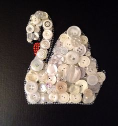 # button art. Mute swan completed using beads and vintage buttons.