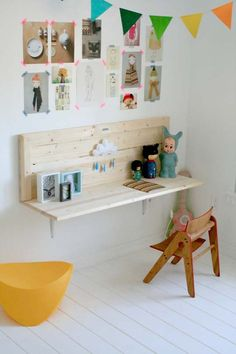 A built in desk saves space in the playroom.