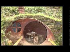 How cool is this little Hobbit garden house? Hobbit Hole, The Hobbit, Fairy Houses, Play Houses, Earth Sheltered Homes, Underground Bunker, Underground Living, Earthship Home, Dome House