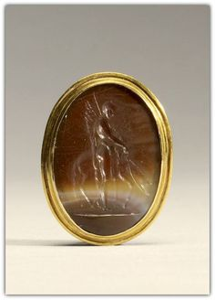 Gem with Intaglio with Bellerophon and Pegasos - sardonyx, gold. Roman early 1st century.