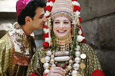 A traditional Jewish Yemeni wedding couple is decked out in colorful garb.   © JIMENA