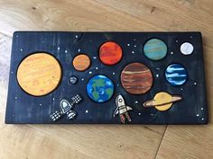 A beautiful wooden puzzle with all of the planets and spacecraft.