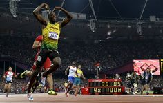 Jamaica's Usain Bolt celebrates his win in the men's 4 x 100-meter relay final by doing the Mo-bot.
