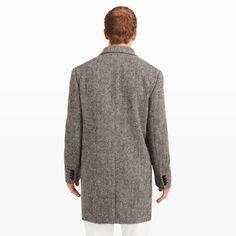"""Few things are as classically handsome as a herringbone coat. This iteration features a warm, speckled wool and a timeless, tailored silhouette you can wear for seasons to come. Shell: wool; Lining: cupro/polyester Straight fit 37 ½"""" center back length, based on a size 40 Double-breasted construction; notched lapel; flower button-hole detail at lapel; single pocket at left chest; black marbled buttons; front flap pockets; four-butto"""