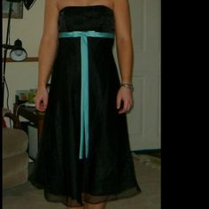 "Alfred Angelou dress Alfred Angelou dress. Worn once as a bridesmaid dress, could be worn for a prom or other occasion...it is black with a chiffon or whatever you call it overlay. The bow is Aqua color and it has a zipper in the back. I am 5'2"" for height reference Alfred Angelo Dresses Prom"