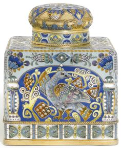 FABERGË~ silver-gilt and cloisonné enamel tea caddy, workmaster Feodor Rückert, Moscow, 1908-1917. Square with domed lid, the sides enameled with polychrome shaded birds among fruit-bearing branches on blue and brown grounds within arched reserves, the borders of columns and formal stylised foliage on pale green and white grounds, the cloisons with dripped overlay, silver-mounted cork stopper, struck K.Fabergé in Cyrillic
