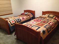 Another view. Quilt on left has navy border while quilt on right has maroon/red. Civil war fabric by Penny Rose.