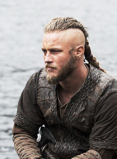 Travis Fimmel as Ragnar Lothbrok on Vikings. I don't like beards or long hair on a guy but I must say he wears this look well !!! (-;  ( he kind of reminds me of Jax Teller)