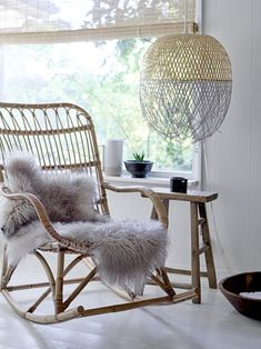 rattan rocking chair with sheepskin lifestyle shot