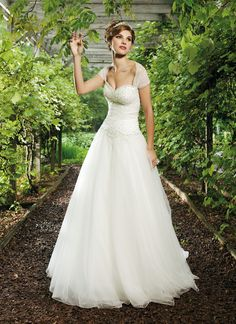 Sincerity wedding dress style 3621 This tulle ball gown has a sweetheart neckline and a lovely circular cut skirt that is scatter beaded with numerous sequins. The dress has a chapel length train and comes with a matching detachable shrug.