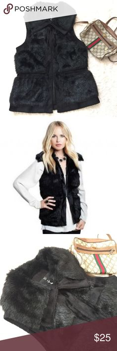 Rachael Zoe pretty faux fur vest Pretty luxe Rachel Zoe faux fur vest in black , with 2 slip pockets , only worn a couple hrs for the party , excellent like new condition , nice and warm also very stylish 😻 Rachel zoe Jackets & Coats Vests
