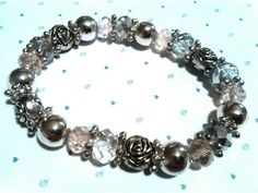 🌸 Beautiful Silver Rose and Crystal Glass Bracelet 🌸    Handcrafted by me, this beautiful bracelet strung on jewellery elastic would make someone special a beautiful gift! It has pretty crystal glass beads and a sprinkling of silver plated rose beads and will be presented in an attractive organza gift bag.    🌸 Thank you for looking today    NualaDesigns 🌸 | eBay!