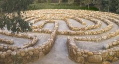Elegant and natural - a perfect combination for a labyrinth.    Andrew Rogers, 'The Winding Path, The Search For Truth', 2010, stone labyrinth at McClelland Gallery & Sculpture Park  The walls are designed to be the right height for seating so that seats do not spoil the flow of the labyrinth. Nice.