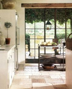 note the beautiful stone floor tiles and the floor to ceiling windows