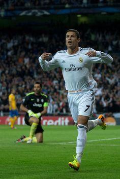 Cristiano Ronaldo celebrates scoring their opening goal during the UEFA Champions League Group B match between Real Madrid CF and Juventus at Estadio Santiago Bernabéu on October 23, 2013 in Madrid, Spain.