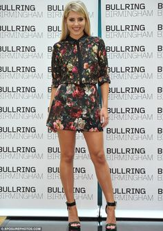 Fun in floral: Mollie King has a quick change of outfit as she poses for photos at the Bullring
