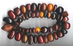 """African """"Amber"""" - phenolic resin or other plastics imitating Baltic Amber. These darker colors are very desired both for their presumed age and the exposure that caused them to darken. Amber Jewelry, Jewelry Art, Gemstone Jewelry, Beaded Jewelry, Ethnic Jewelry, African Trade Beads, Amber Stone, How To Make Beads, Stone Beads"""