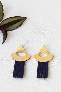 Eco earrings by Shlomit Ofir. Dangle golden earrings with a half moon element and faux-suede strands in midnight blue.
