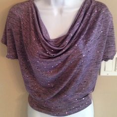 Purple sparkle NWT TOP size s Purple sparkle NWT TOP size s. Stretchy and will fit size small or medium. heart and soul Tops