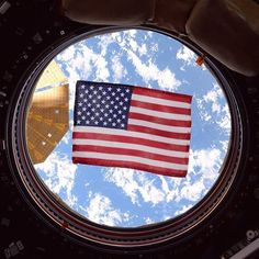 nasa Today is #FlagDay, commemorating the adoption of the United States flag, which took place on June 14, 1777. Seen here is the American flag in one of the windows of the International Space Station's (@iss) cupola, a dome-shaped module through which operations on the outside of the station can be observed and guided. Astronaut Jack Fischer took this photograph and shared it on social media.  Throughout NASA's history, spacecraft and launch vehicles have always been decorated with flags…