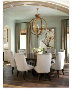 Oversized chairs in dinning room. Round table.