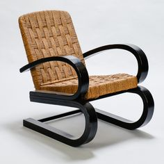 """Italian Bent Wood and Woven Rush Armchair In The Manner of Audoux Minet  --  Circa 1950s arm chair found in Italy with double form dark bent wood arms and woven rush seat and back in the manner of Audoux Minet. Seat is 16.5"""" high and 19.5"""" deep. Very good vintage condition.   --   Item:  7235  --  Price:  $3295"""
