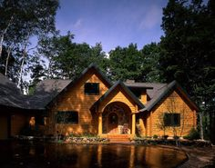 Great landscaping accents this log home.