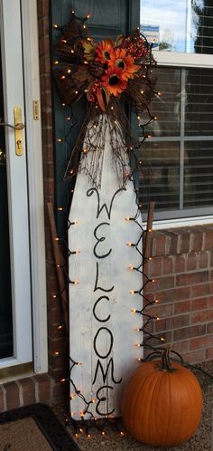 Front porch welcome sign. Old ironing board.