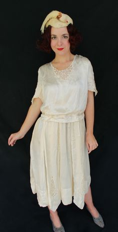 AMAZING white silk 1920s flapper wedding dress purchased from the family of the original owner.  The dress has handmade (Flemish?) lace inserts on the collar, sleeves, and as insets in the ends of the waist sash.  Excellent condition, coming soon!