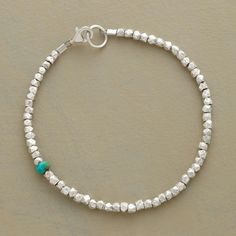 "SINGULAR MOMENT BRACELET -- A single rondelle of turquoise makes a surprise appearance among faceted sterling silver nuggets in a bracelet you'll want to wear every day. Made in USA. Exclusive. Approx. 7-1/4""L."