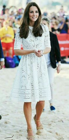The Duchess selected an Australian designer for a lifesaving event on Manly  Beach in Sydney, wearing a white eyelet Zimmermann dress and styling it  with ...