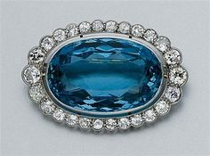 Aquamarine and Diamond Brooch   Platinum, centering one oval aquamarine, approximately 35.25 cts., framed by a scalloped border of 26 old European-cut diamonds, approximately 4.35 cts., circa 1910, approximately 11.2 dwt.