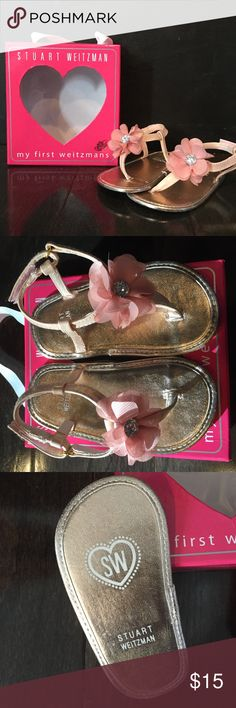 Stuart Weitzman: my first weitzmans Baby Sandals Like new, in box! Adorable sandals for baby girl. The straps and sole are a rose gold color adorned with a rhinestone-centered pink flower. Velcro closure on back. These were worn for less than an hour in our house, on carpet. Size 4 is supposed to be 9-12 months, but to me they ran a little large. Stuart Weitzman Shoes Baby & Walker