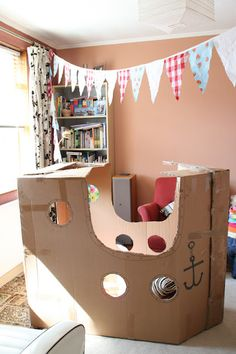 make a simple cardboard box pirate ship for pretend play