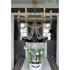 Gabby nadia chandelier candelabra inc light it up pinterest refined rustic meets transitional in gabbys nadia a beaded 6 candle circle chandelier strung in white washed wood beads on a rust black iron frame aloadofball Gallery