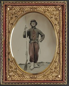[Unidentified soldier in Union zouave uniform with bayoneted musket] (LOC) by The Library of Congress, via Flickr