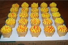 Olympic Torch Parade Cupcakes in a ice cream cone - I made these for my son's preschool Olympic parade. I made them for all the 4 & 5 year olds. They gave me the supplies and I made them at home. I forget what magazine these were in, I already gave it back to the preschool. They were supposed to have fruit roll ups as part of the flames but I couldn't get it to stand up. So instead, I striped my bag red and orange & used yellow buttercream icing. Olympic Idea, Olympic Flame, Cupcake Cones, Cupcake Ideas, Fruit Roll Ups, Good Food, Fun Food, Easy Party Food, Buttercream Icing