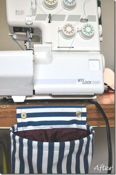 Serger thread catcher.( ** - with a longer piece of fabric that goes under the serger, you wouldn't need to screw the thread catcher to the table....)