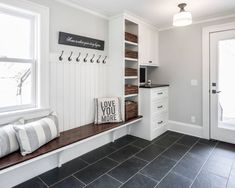 A mudroom or an entryway is usually a small space that needs a lot of storage to hold lots of stuff. We've gathered lots of small mudroom storage ideas for you. Mudroom Laundry Room, Bench Mudroom, Mudroom Cubbies, Mud Room Lockers, Mudrooms With Laundry, Garage Lockers, Built In Lockers, Garage Laundry, Wall Bench