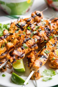 Grilled Chicken Skewers with a Sweet Sriracha Glaze ~ spicy and sweet is always a fantastic combination especially when slathered onto tender chunks of grilled chicken.  This simple sweet sauce caramelizes the chicken, leaving it tender and juicy with a just a little hint of heat. www.savingdessert.com