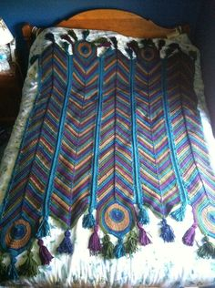 Gorgeous! Peacock afghan. I found this on Facebook: https://www.facebook.com/photo.php?fbid=10152540815811283&set=o.116482731742088&type=1&theater