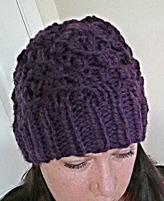 Hand knitted purple hat.