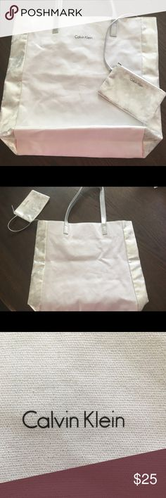 New Calvin Klein tote and change pouch Brand new , no tags -Calvin Klein tote bag with change pouch. White and silver. Silver portion is very soft material. Fast Shipping, smoke free! Calvin Klein Bags Totes