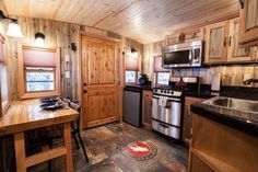 A caboose tiny house vacation in Essex, Montana with multiple repurposed cabooses that have been renovated into tiny homes you can stay in.
