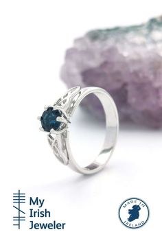 This delightful 14k ring is certain to capture the moment with one of the most sought after gemstones ever. Presented as an engagement ring sapphires represent faithfulness and sincerity.The royal blue sapphire radiates color due to the clever faceting and precision cutting of the stone. Sapphire is a hard wearing stone, making them the ideal choice of ring for everyday wear. Irish Engagement Rings, Irish Wedding Rings, Irish Rings, Celtic Rings, White Gold Sapphire Ring, Blue Sapphire, Shoulder Jewelry, Trinity Knot, Gold Style