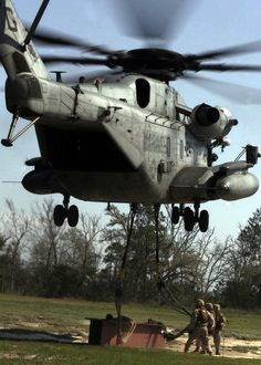 Marines from Marine Corps Base Camp Lejeune connect a beam to one of HMH-366's CH-53E Super Stallions during training March 20, near MCB Camp Lejeune. The CH-53E helicopter is the only helicopter in the Department of Defense that is certified as a heavy-lift helicopter.
