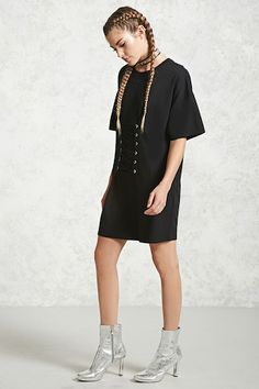 Forever 21  - A mini T-shirt dress featuring a crew neckline, short sleeves, and a front crisscross lace with grommets detail.