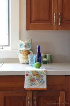 cleaning cherry kitchen cabinets. Cleaning tip, but I love the owl.